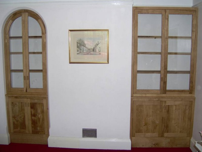 Fitted glazed oak display cabinets