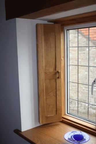 Wooden shutters in  casement window